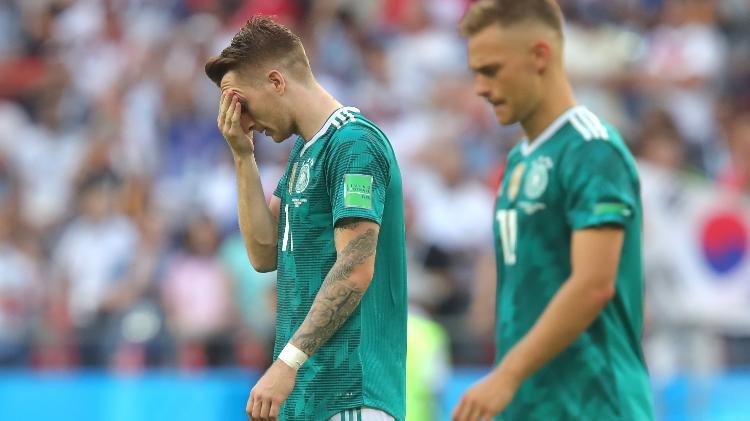 marco reus leva mao ao rosto decepcionado com derrota da alemanha