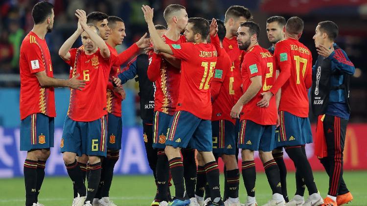 time da espanha celebra vitoria sobre o marrocos